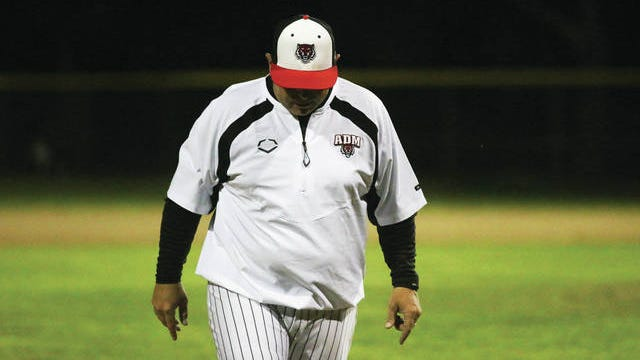 ADM baseball head coach Jason Book heads back to the dugout following the conclusion of an innng this season. PHOTO BY ANDREW BROWN/DALLAS COUNTY NEWS