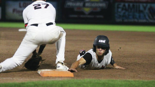 Ethan Juergens slides back into first base Tuesday, July 28 against Gilbert in the state quarterfinal match-up. PHOTO BY ANDREW BROWN/DALLAS COUNTY NEWS
