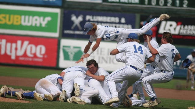 Van Meter baseball players celebrating after capturing their second straight state title Saturday, August 1. PHOTO BY ANDREW BROWN/DALLAS COUNTY NEWS