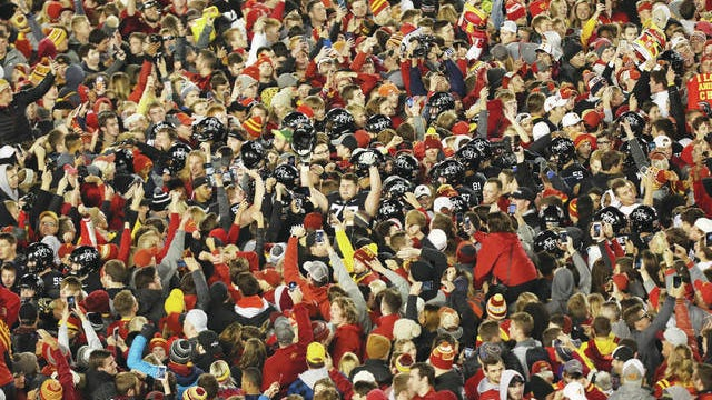 Iowa State students and fans rush the field and surround the team after the Cyclones beat West Virginia at Jack Trice Stadium in 2018. Photo by Reese Strickland-USA TODAY Sports