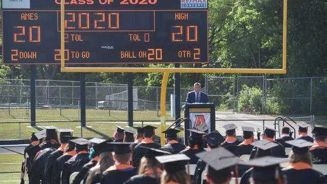 This year's Ames High Commencement ceremony took place outdoors at the Ames High Stadium, where students and families were required to wear a mask throughout the hour long ceremony. Photo by Kiley Wellendorf/Ames Tribune