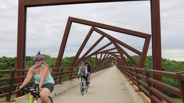 Hundreds of bicyclists took advantage took to High Trestle Trail on Sunday afternoon. Families also enjoyed the warm weather by walking, eating picnics and taking photos of trail's bridge, located roughly three miles west of Madrid. Photo by Kylee Mullen