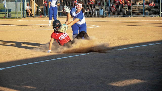 Macy Kilmer works to tag a Gilbert player on Tuesday, June 16. PHOTO BY SEAN CORDY/THE PERRY CHIEF