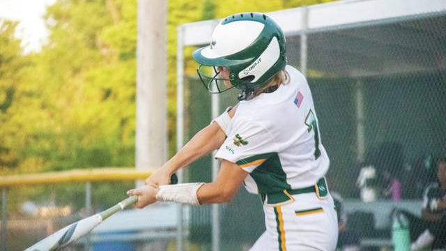 Chloe Houge swings at a pitch during the July 2 contest with Des Moines Christian. PHOTO BY SEAN CORDY/THE PERRY CHIEF