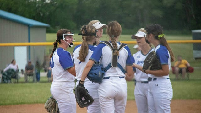 Perry softball players meet at the mound during a game earlier this season. PHOTO BY SEAN CORDY/THE PERRY CHIEF