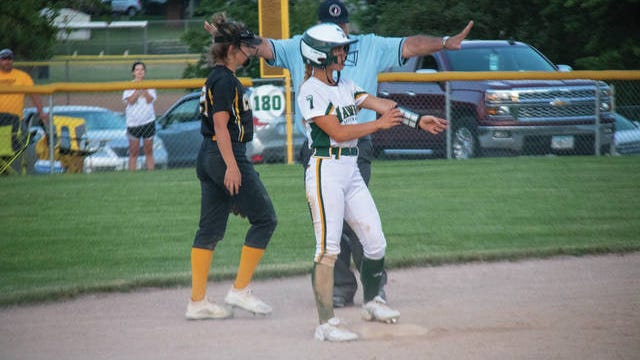 Chloe Houge is safe after sliding into base against ACGC. PHOTO BY SEAN CORDY/THE PERRY CHIEF