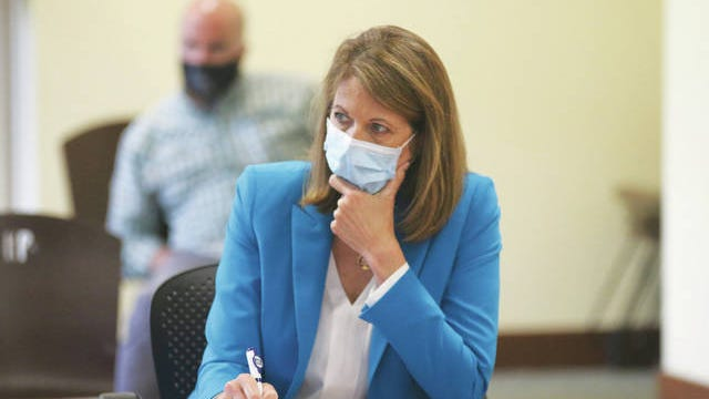 U.S. Rep. Cindy Axne listens to local business and city leaders during an August visit to Perry. Andrew Brown/The Perry Chief