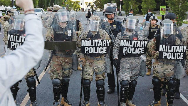 National Guard military police officers block demonstrators during a protest against the death of George Floyd, near the White House in Washington, D.C., on Monday, June 1, 2020. Yuri Gripas/Abaca Press/TNS