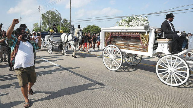 A horse-drawn hearse containing the remains of George Floyd makes its way to the Houston Memorial Gardens cemetery on Tuesday, June 9, 2020, in Houston. Floyd died May 25 while in Minneapolis police custody, sparking protests nationwide and across the globe. Joe Raedle/Getty Images/TNS