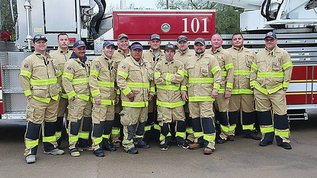A group of Pawhuska firefighters is shown in some of the department's new protective gear. Pictured are, from left, Justin Chinn, Jeremie Tuller, Randy Wadsworth, Colby Crawford, Gip Allen, Melvin Blossom, Josh Alexander, Dalton McCosar, Lloyd Arnce, Jeremy Smith, Mike Bayro, Dakota Jester and Tracy Fitzgerald. Photo by Robert Smith/Pawhuska Journal-Capital