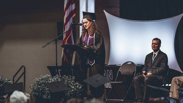 Abby Witt delivers her speech to her fellow 2020 graduates and the audience during the Wesleyan Christian School high school commencement. Andy Dossett/For the E-E