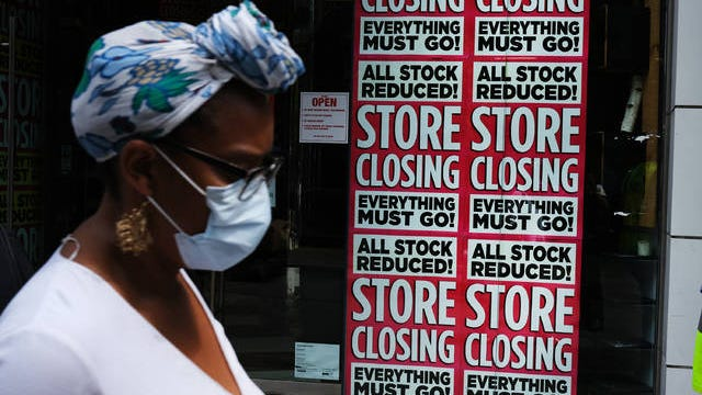 A store in Brooklynadvertises a sale on July 7, 2020. Spencer Platt/Getty Images/TNS
