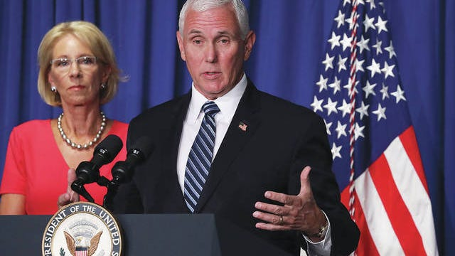 Vice President Mike Pence speaks as Secretary of Education Betsy DeVos listens during a White House Coronavirus Task Force press briefing at the U.S. Department of Education July 8, 2020, in Washington, D.C. Alex Wong/Getty Images