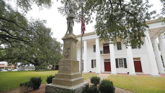 A statue commemorating fallen confederate soldiers stands on front of the East Feliciana Parish Courthouse in Clinton, La., on Aug. 1, 2018. Gerald Herbert/AP, file