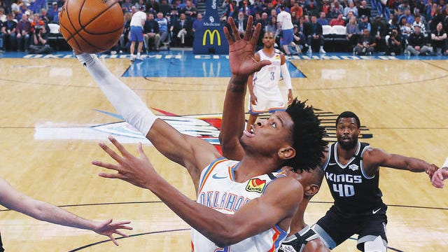Oklahoma City Thunder guard Shai Gilgeous-Alexander shoots in front of Sacramento Kings forward Harry Giles III during the first half of an NBA game Feb. 27, 2020, in Oklahoma City. The Thunder were one of the hottest teams in the NBA before the coronavirus pandemic hit. Sue Ogrocki/AP file