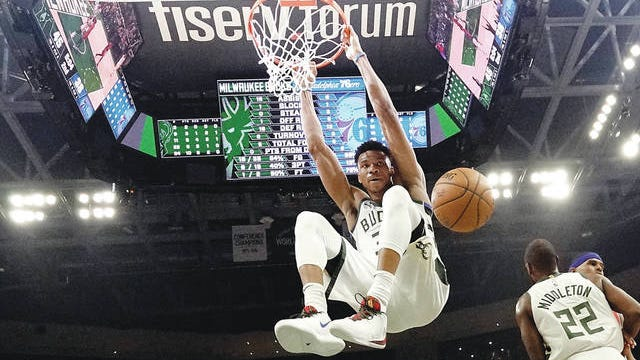 Milwaukee Bucks' Giannis Antetokounmpo dunks during the first half of a game Feb. 22, 2020, against the Philadelphia 76ers in Milwaukee. Morry Gash/AP, file