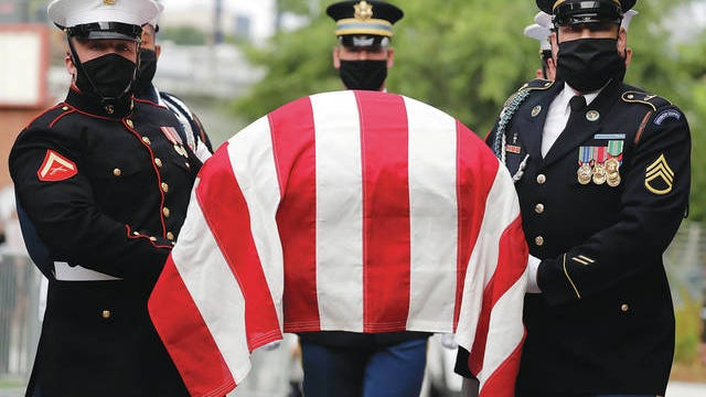 A military honor guard moved the casket of Rep. John Lewis into Ebenezer Baptist Church for his funeral, Thursday, July 30, 2020, in Atlanta. Brynn Anderson/AP