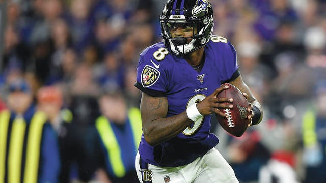 Baltimore Ravens quarterback Lamar Jackson rolls out of the pocket during the first half an NFL divisional playoff game against Tennessee on Jan. 11, 2020, in Baltimore. Gail Burton/AP file