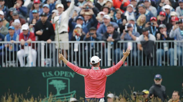 Gary Woodland celebrates in front of fans after winning the U.S. Open golf tournament June 16, 2019, in Pebble Beach, Calif. Marcio Jose Sanchez/AP file