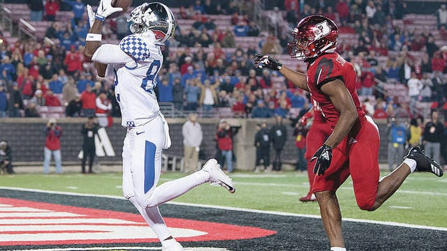 Kentucky wide receiver Josh Ali catches a touchdown pass during the team's game against Louisville on Nov. 24, 2018, in Louisville, Ky. Bryan Woolston/AP file