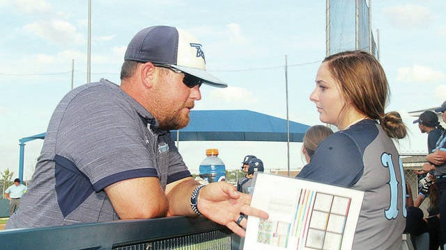 Bartlesville High School head softball coach Kyle Minton talks with Kaitlyn Sanders during action last season at the Lady Bruin Complex. Mike Tupa/Examiner-Enterprise
