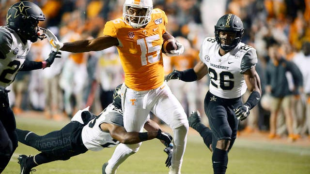 Tennessee wide receiver Jauan Jennings (15) runs through Vanderbilt defenders during the second half of an NCAA college football game on Nov. 30, 2019 in Knoxville.