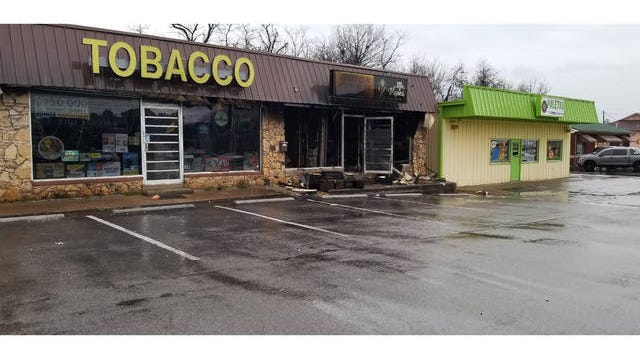 A fire swept through the Quick Cash and Mr. Vapes shop located on James Campbell Boulevard late Thursday.