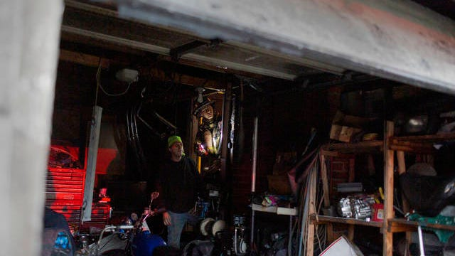 Columbia Fire and Rescue Captain Jose Periut Jr. inspects a garage inside the home of Jeff Wright on Santa Fe Pike following a fire on Friday, Jan. 3, 2020.