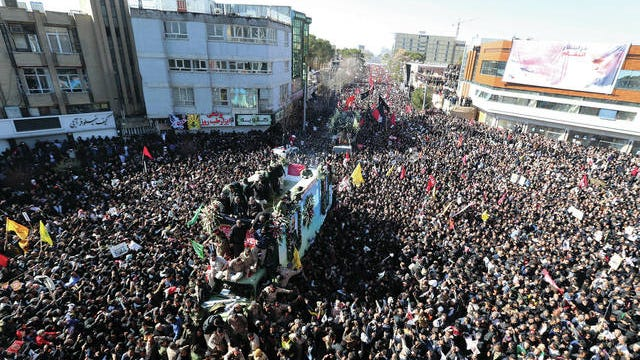 Coffins of Gen. Qassem Soleimani and others who were killed in Iraq by a U.S. drone strike, are carried on a truck surrounded by mourners during a funeral procession, in the city of Kerman, Iran, Tuesday. A stampede erupted on Tuesday at a funeral procession for a top Iranian general killed in a U.S. airstrike last week, killing 35 people and injuring 48 others, state television reported.