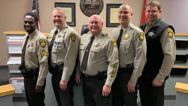 Sergeant Duane Sayle, Lieutenant Marcus Albright, Captain Dwight Fautt and Chief Deputy Mike Barnes pose with Sheriff Bucky Rowland after being sworn in on Jan. 3, 2020.