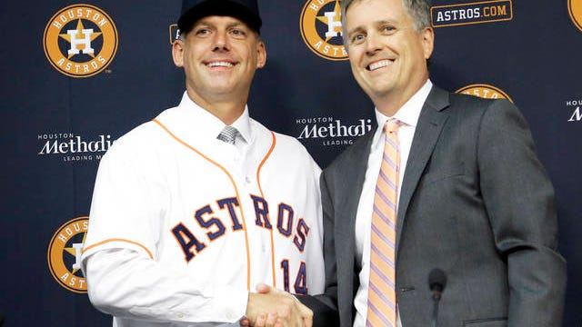 In this Sept. 29, 2014 file photo, Houston Astros general manager Jeff Luhnow, right, and A.J. Hinch pose after Hinch is introduced as the new manager of the baseball club in Houston. Hinch and Luhnow were fired Monday after being suspended for their roles in the team's extensive sign-stealing scheme from 2017.