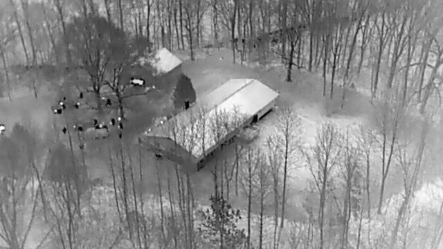 The Lawrence County Sheriff's Department raids a home located in the western portion of the county on Wednesday, Jan. 8, 2020. The raid was videotaped using an infrared camera placed drone operated by the Lawrence County Fire Department.