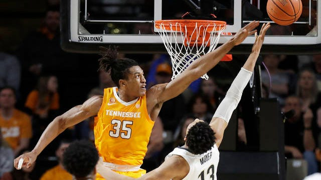 Vanderbilt struggled to score beyond or inside the 3-point arc Saturday night, with Tennessee's Yves Pons (35) blocking a shot by Matthew Moyer (13) and the Commodores missing all 25 of their long-range attempts during the visiting Volunteeers' 66-45 victory.