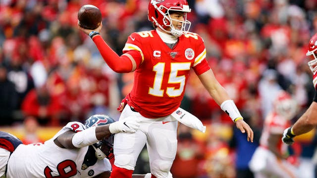 Kansas City Chiefs quarterback Patrick Mahomes (15) throws under pressure from Houston Texans defensive end Charles Omenihu (94) during the first half of an NFL divisional playoff football game, in Kansas City, Missouri, on Sunday, Jan. 12.