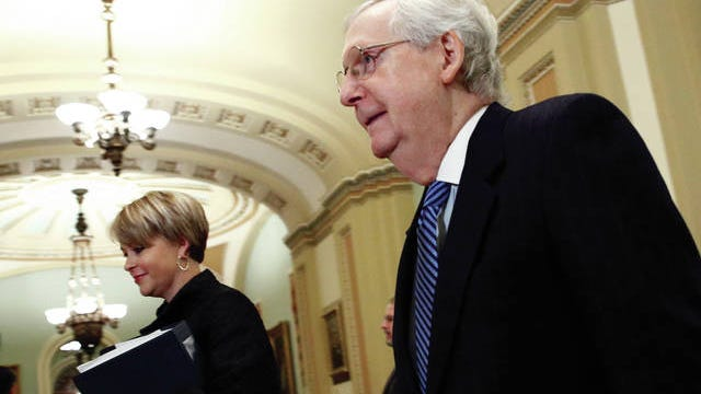 Senate majority leader Mitch McConnell, R-KY., walks to the Senate chamber for the impeachment trial of President Donald Trump at the Capitol, Wednesday, Jan. 22, 2020, in Washington.