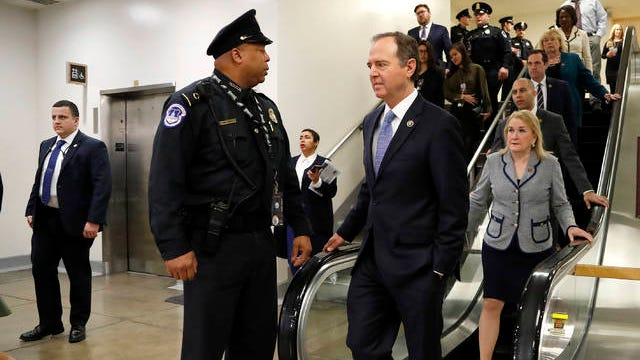 House Democratic impeachment manager Rep. Adam Schiff, D-Calif., fourth from left, is followed by impeachment managers Rep. Sylvia Garcia, D-Texas, Rep. Hakeem Jeffries, D-N.Y., Rep. Jason Crow, D-Colo., Rep. Zoe Lofgren, D-Calif., and Rep. Val Demings, D-Fla., takes an escalator while heading to talk to reporters on Capitol Hill in Washington, Thursday, during the impeachment trial of President Donald Trump on charges of abuse of power and obstruction of Congress.