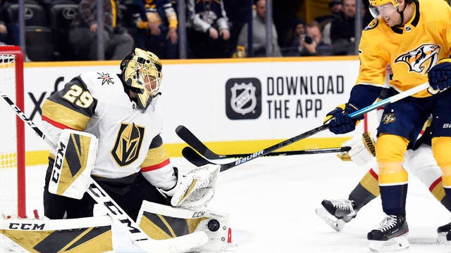 Vegas Golden Knights goaltender Marc-Andre Fleury (29) blocks a shot by Nashville Predators right wing Craig Smith (15) during the second period of an NHL hockey game Saturday in Nashville.