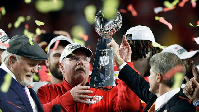 Kansas City Chiefs chairman Clark Hunt, right, hands the trophy to head coach Andy Reid after the chiefs defeated the San Francisco 49ers in the NFL Super Bowl 54 football game Sunday in Miami Gardens, Fla.