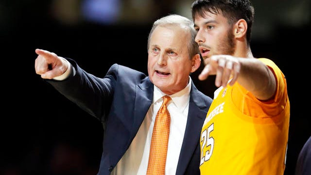Tennessee coach Rick Barnes talks with guard Santiago Vescovi during the second half of the team's NCAA college basketball game against Vanderbilt on Jan. 18 in Nashville. Tennessee won 66-45.