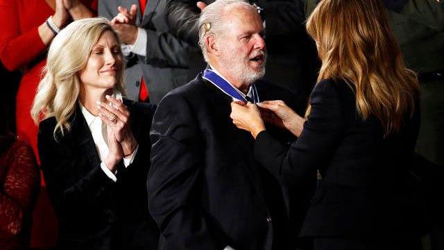 First Lady Melania Trump presents the Presidential Medal of Freedom to Rush Limbaugh as his wife Kathryn watches during the State of the Union address to a joint session of Congress on Capitol Hill in Washington Tuesday.