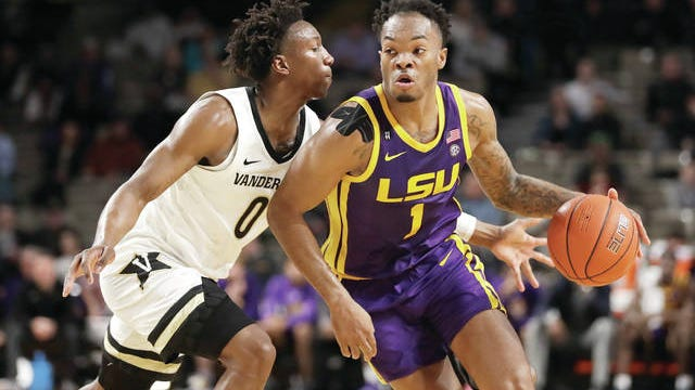Vanderbilt's Saben Lee (left) scored a game-high 33 points Wednesday night as the Commodores snapped an SEC-record 26-game losing streak in regular-season league play with a 99-90 win over visiting conference leader LSU.