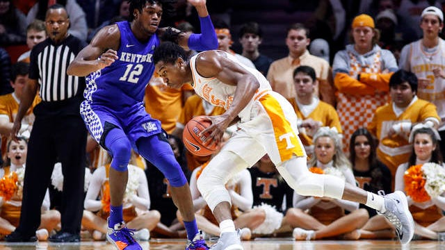 Tennessee guard Yves Pons (35) drives to the basket as he's defended by Kentucky forward Keion Brooks Jr. (12) during an NCAA college basketball game Saturday in Knoxville. Kentucky won 77-64.