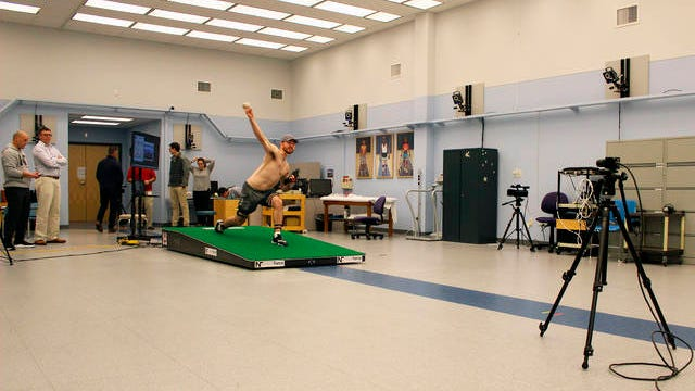 Central Connecticut pitcher Michael DeLease throws off a smart mound at the Center for Motion Analysis in Farmington, Conn. on Jan. 28. The new technology allows scientists to better study pitching mechanics to enhance efficiency and prevent injuries.
