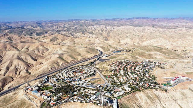 """This Jan. 26 file photo, shows a view of the West Bank Jewish settlement of Mitzpe Yeriho. The United Nations Human Rights Council released a list of more than 100 companies it says are operating in Israel's West Bank settlements. In a report Wednesday, the council said the companies' activities """"raised particular human rights concerns."""" The list is dominated by Israeli companies, but it also lists a number of international firms."""