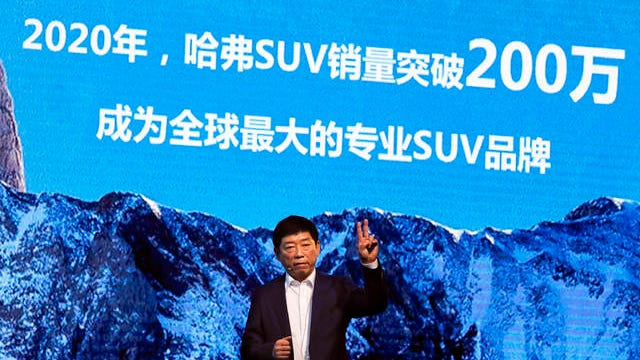 """In this Feb. 19, 2017 file photo, Wei Jianjun, chairman of Great Wall Motors Ltd., gestures as he speaks during an event celebrating it sales passing the one million mark, at the Great Wall headquarters in Baoding in north China's Hebei province. General Motors decision to pull out of Australia, New Zealand and Thailand as part of a strategy to exit markets that don't produce adequate returns on investments raised dismay Monday from officials concerned over job losses. The words behind reads """"By 2020, Haval SUV sales will pass 2 million, become the world's biggest specialty SUV brand."""""""