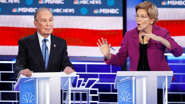 Democratic presidential candidates, former New York City Mayor Mike Bloomberg, left, listens as Sen. Elizabeth Warren, D-Mass., speak during a Democratic presidential primary debate Wednesday in Las Vegas, hosted by NBC News and MSNBC.