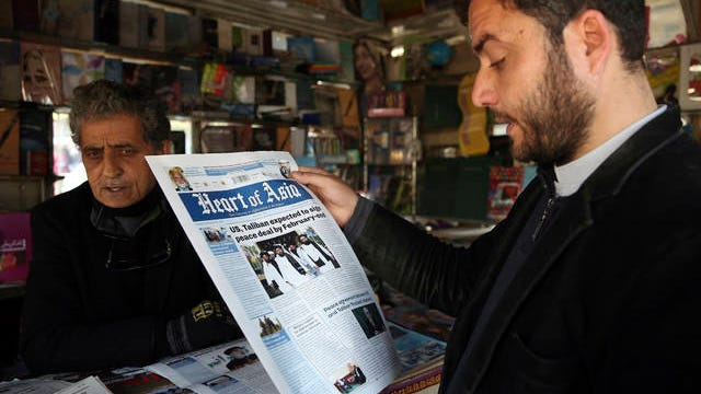 A man reads a newspaper about peace talks in Kabul, Afghanistan on Saturday. A temporary truce between the United States and the Taliban took effect on Friday, setting the stage for the two sides to sign a peace deal this week aimed at ending 18 years of war in Afghanistan and bringing U.S. troops home.