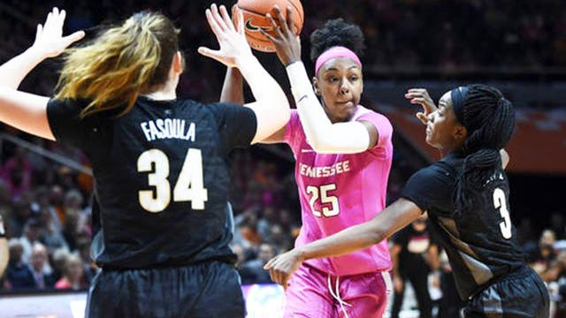 Tennessee guard Jordan Horston (25) is guarded by Vanderbilt forward Mariella Fasoula (34) and guard Jordyn Cambridge (3) in the NCAA women's basketball game at Thompson-Boling Arena on Sunday.