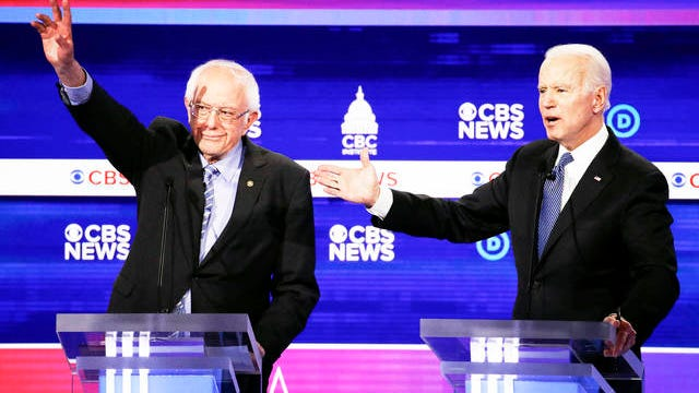 Democratic presidential candidates, Sen. Bernie Sanders, I-Vt., left, and former Vice President Joe Biden, right, participate in a Democratic presidential primary debate at the Gaillard Center Tuesday in Charleston, S.C., co-hosted by CBS News and the Congressional Black Caucus Institute.