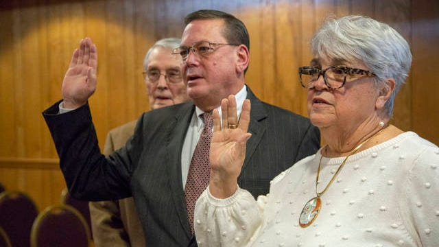 Mt. Pleasant Mayor Bill White, center, and Vice Mayor Delores Blankenship, right, are sworn in to serve the city, joined by White's father William White inside the Tom Hardin Commission Room at City Hall on Tuesday, Dec. 19, 2018.